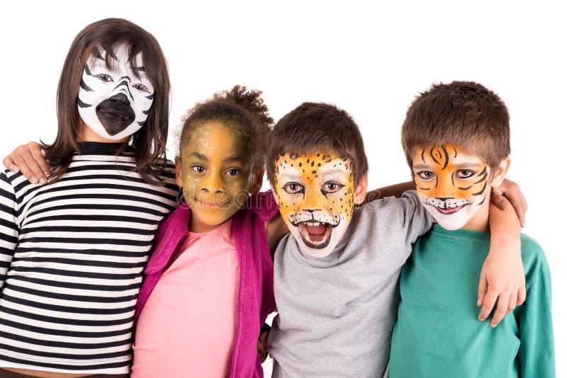 Niños con la cara-pintura foto de archivo