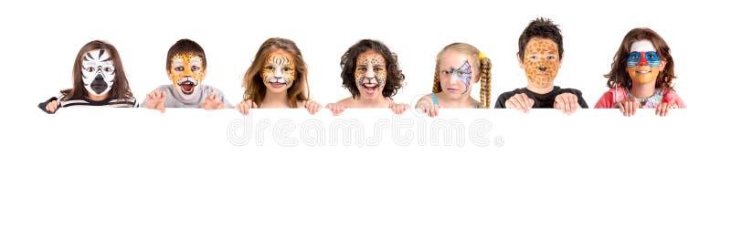 Niños con la cara-pintura animal fotos de archivo libres de regalías