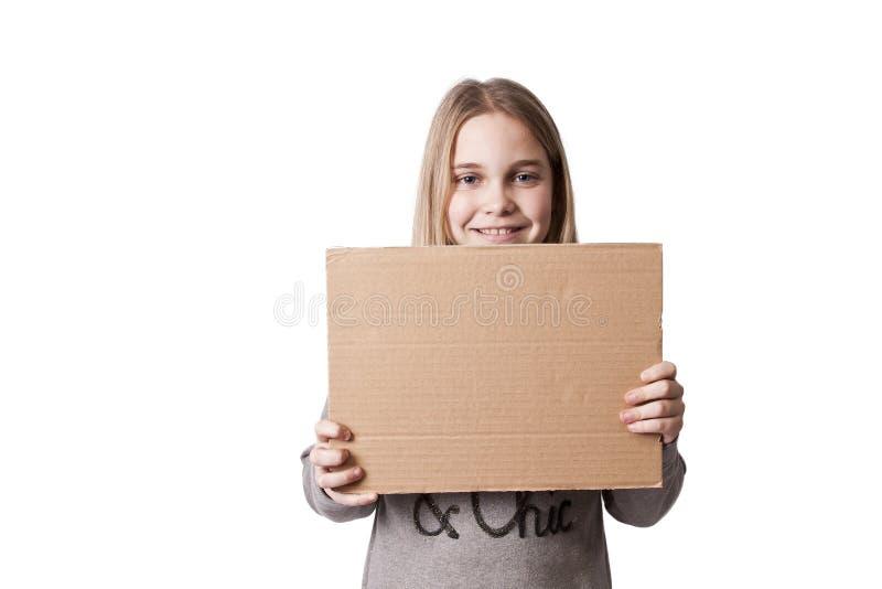 Niños con las muestras de la cartulina foto de archivo