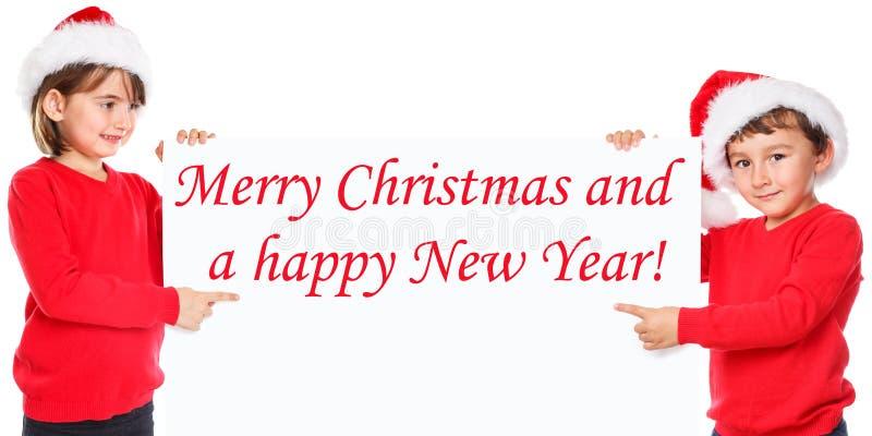 Niños de los niños de la tarjeta de Santa Claus Merry Christmas que señalan la mirada fotografía de archivo libre de regalías
