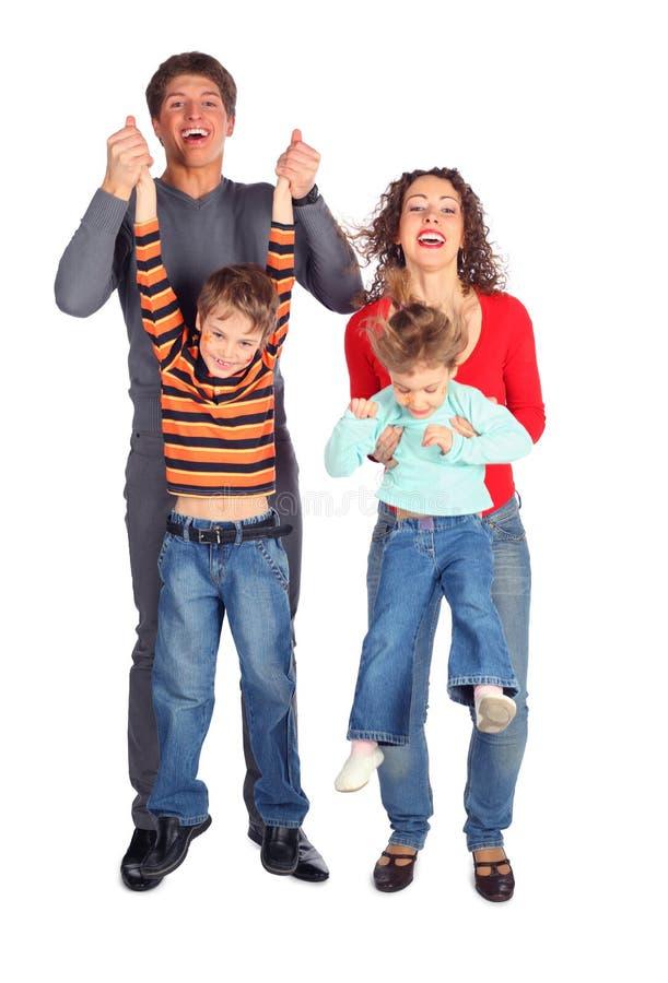 Niños del asimiento de los padres para las manos foto de archivo