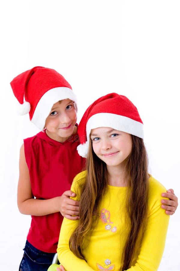 Niños en casquillos de la Navidad imágenes de archivo libres de regalías