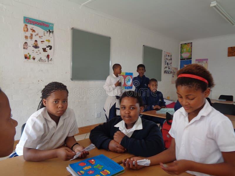 Niños en clase imagen de archivo