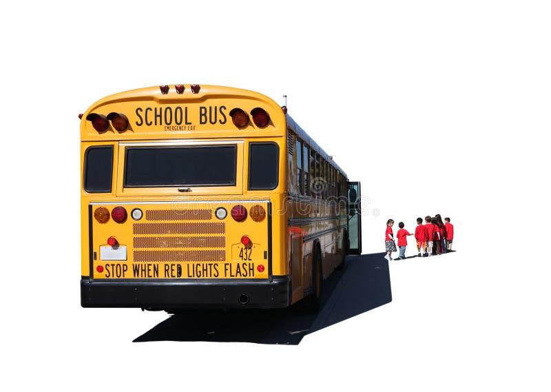 Niños envejecidos escuela que salen un autobús escolar fotos de archivo libres de regalías