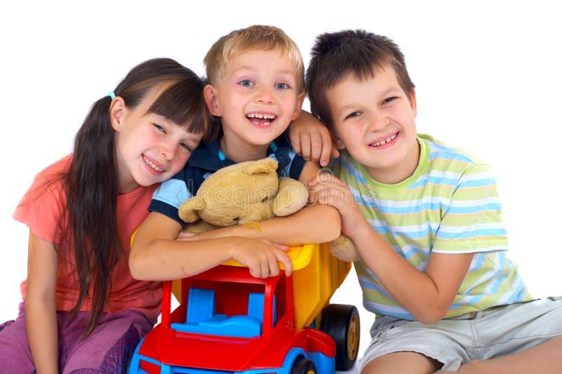 Niños felices con los juguetes imágenes de archivo libres de regalías