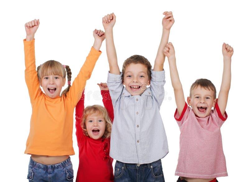 Niños felices con sus manos para arriba fotos de archivo