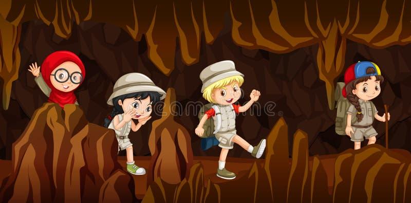 Niños jovenes que exploran una cueva stock de ilustración