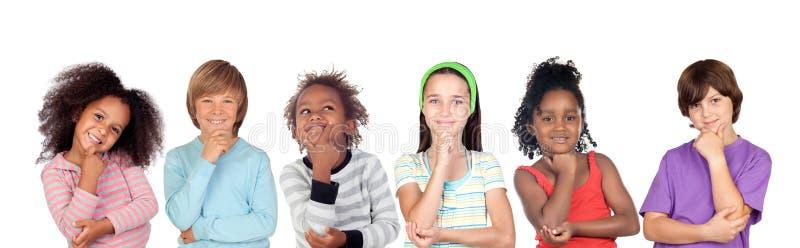 Niños pensativos imagen de archivo libre de regalías