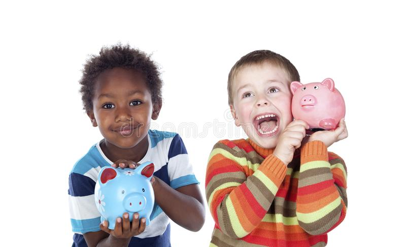 Niños que ahorran con su hucha imágenes de archivo libres de regalías