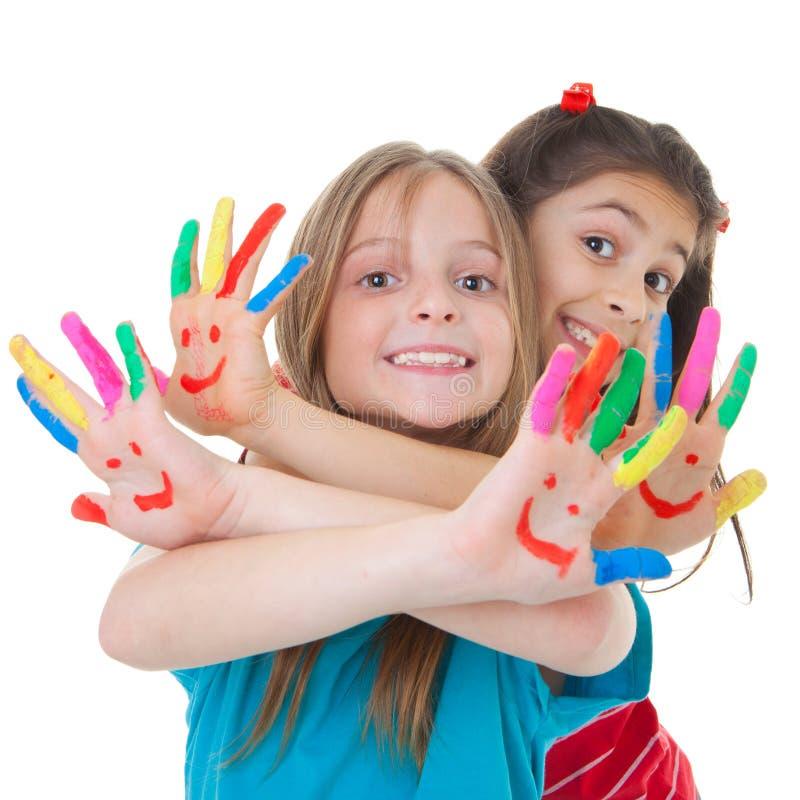 Niños que juegan con la pintura foto de archivo
