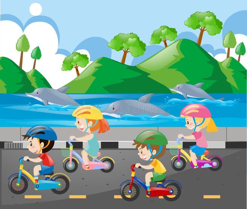 Niños que montan la bici a lo largo del océano libre illustration