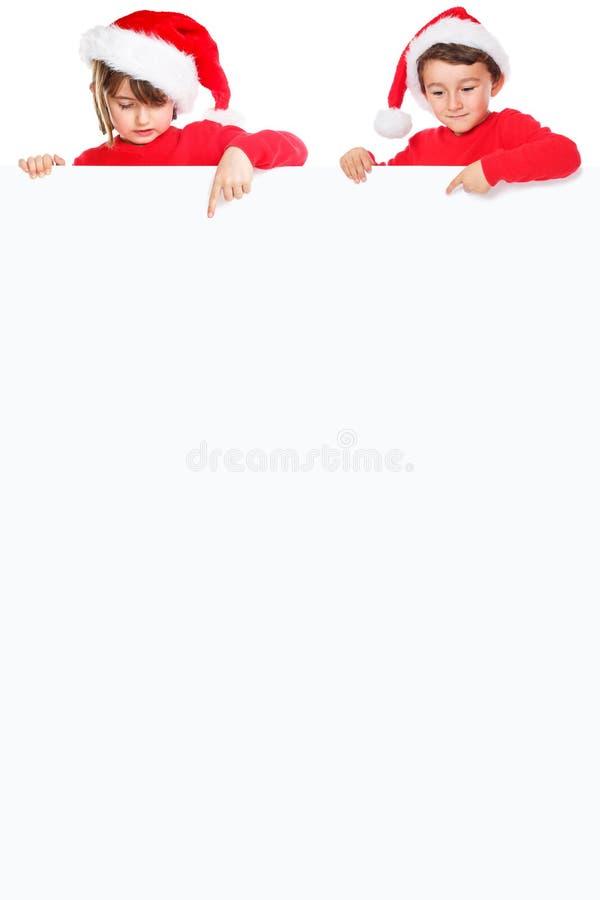 Niños Santa Claus de los niños de la Navidad que señala portra vacío de la bandera fotografía de archivo