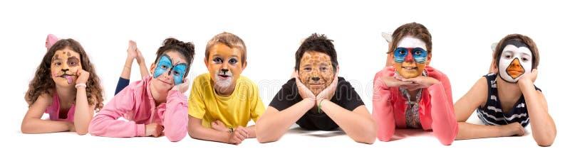 Ni?os con la cara-pintura animal fotos de archivo libres de regalías