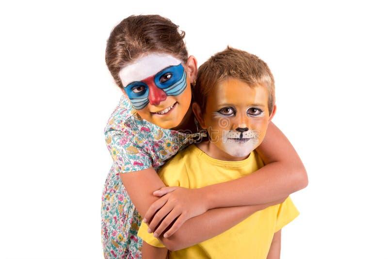 Ni?os con la cara-pintura animal imágenes de archivo libres de regalías