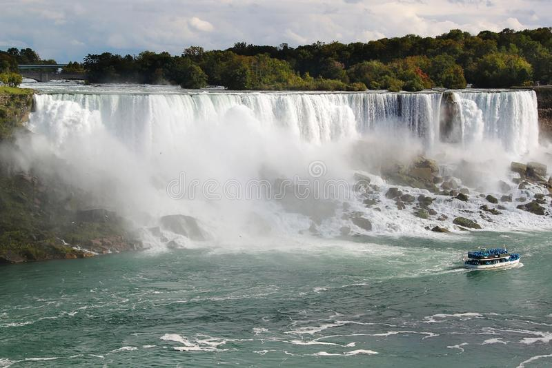 Niagara fall Horseshoe. Ontario. Beautiful waterfall on blue sky and white clouds background. royalty free stock images