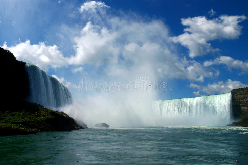 Niagara falls. The Niagara Falls are the most powerful waterfalls in North America. These voluminous waterfalls are situated on the Niagara River, which drains stock photo