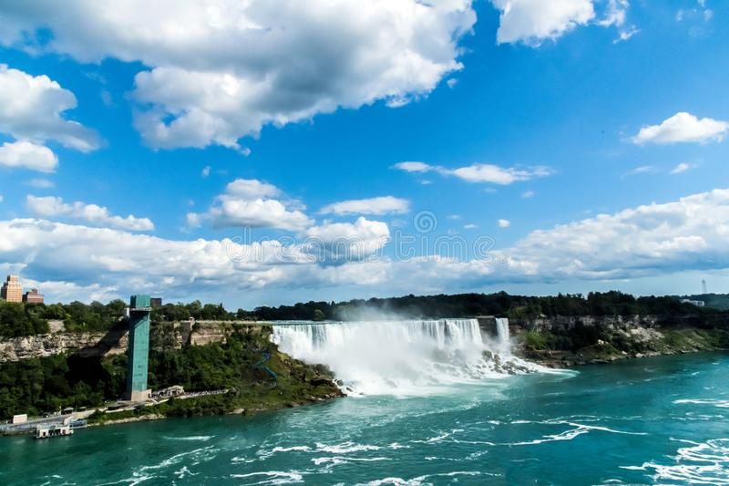 Niagara Falls American Falls on a summer day at the international border between Canada and the USA. royalty free stock image