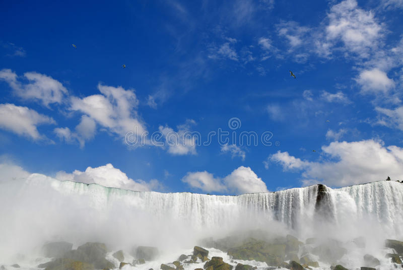 Niagara Falls in Buffalo area, New York, United States. Blue sky and waterfall stock images