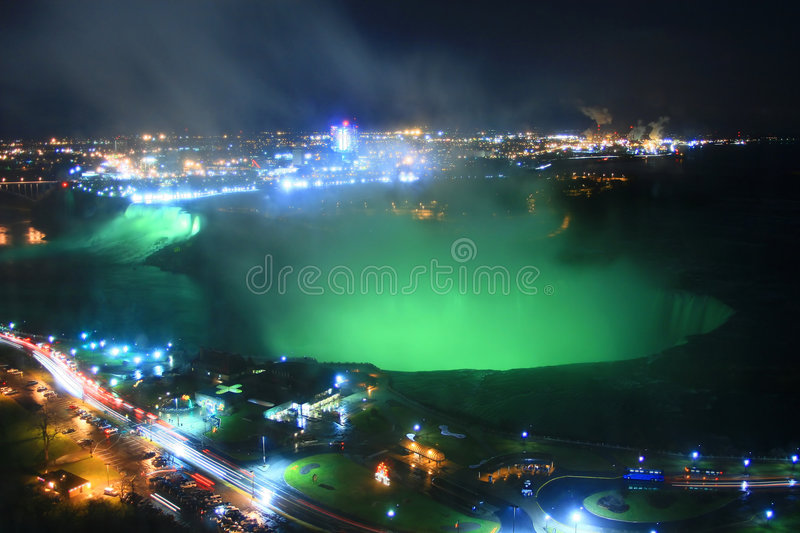 Niagara Falls at Night. The great falls of Niagara are bathed in an eerie green night-time glow royalty free stock photography