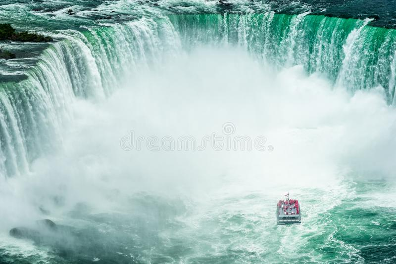 Niagara Falls with Passenger Ship. High Angle view on Passenger Ship approaching the Niagara Falls, seen from Canadian side stock photos