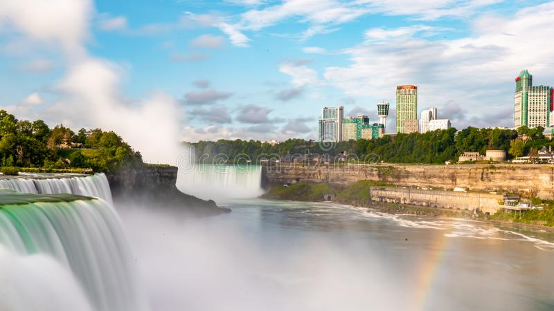 Niagara Falls on America side in the morning with clear sky , Buffalo , United States of America. Niagara Falls with rainbow from America side in the morning stock photos