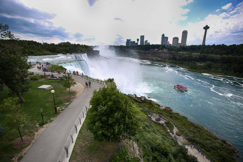 Niagara Falls, USA – August 29, 2018: Tourists view the Niagara Falls the Canadian side with famous hotels across from the Amer royalty free stock images