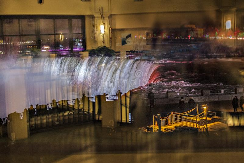 Niagara Falls . View from the shop window at night. Niagara Falls . Beautiful background of the waterfall at night.. Rushing stream stock image