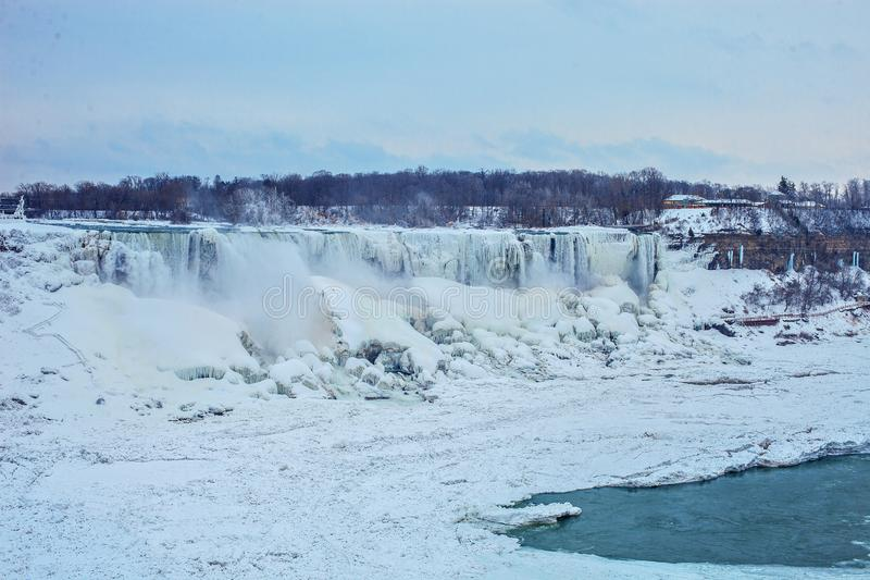 Niagara Falls in winter. Frozen Waterfall in February. Niagara Falls in the winter with snow and ice, and fog created by the cold temperature stock photos