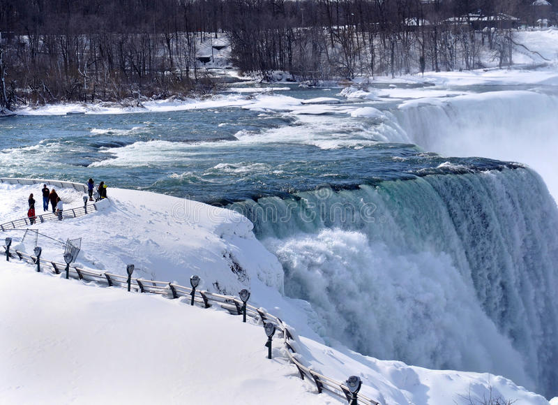 Niagara Falls in Winter. With visitors standing at the edge stock image