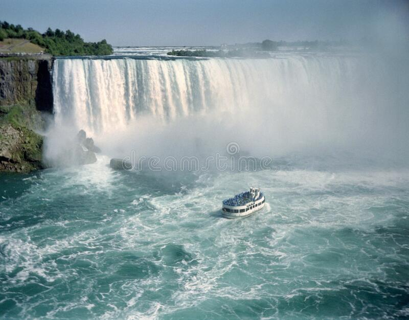 Niagara River Falls and Tour Boat royalty free stock images