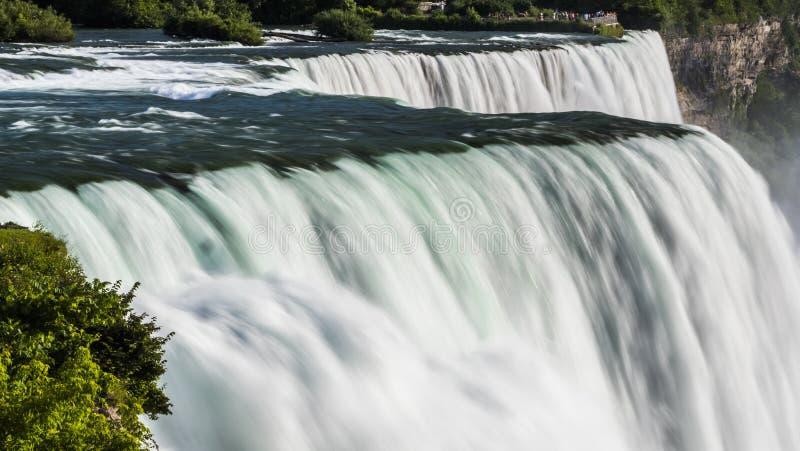 Niagara River and the mighty Niagara Falls. Nature and sights of America. Long exposure shot. Niagara River and the mighty Niagara Falls. Nature and sights of royalty free stock photos
