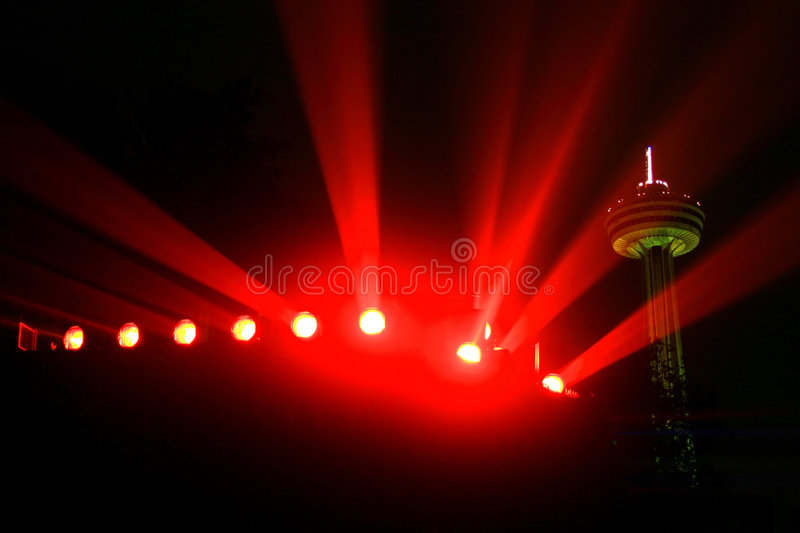 Niagara's colored floodlights accompanied by the Skylon Tower in the background. The Colored Floodlights of Niagara's Falls stock images