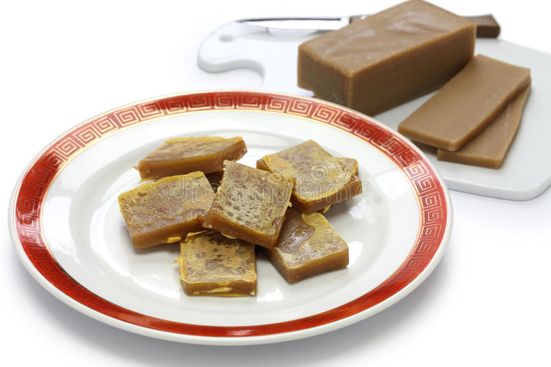 Nian gao, chinese new year rice cake. Cooked & uncooked royalty free stock photos