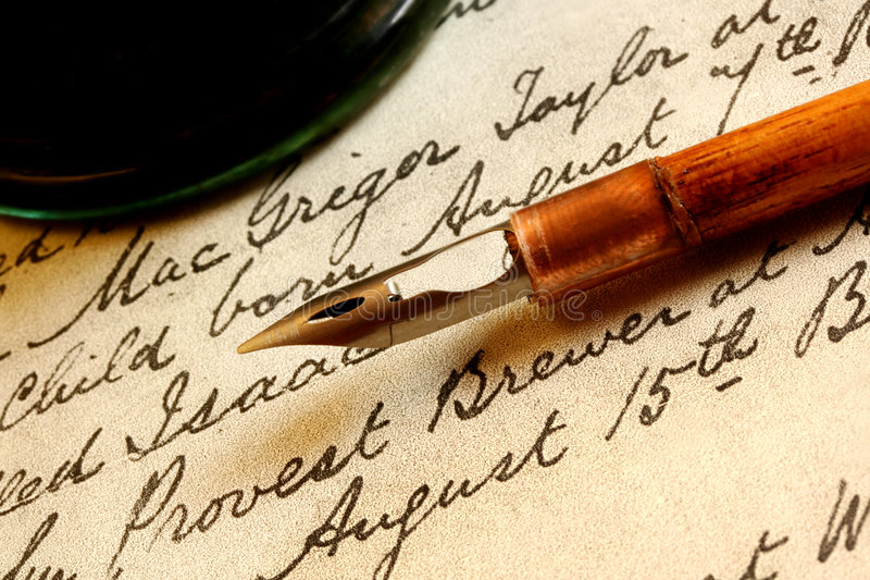 Nib Pen and Inkwell. Antique nib pen and inwell, on a page of 18th century text stock image