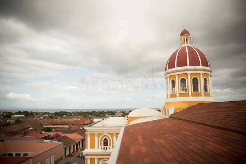 Nicaragua Cathedral on a Cloudy Day. Nicaragua cathedral chapel steeple on a cloudy day. Yellow building with terracotta tiles stock photos
