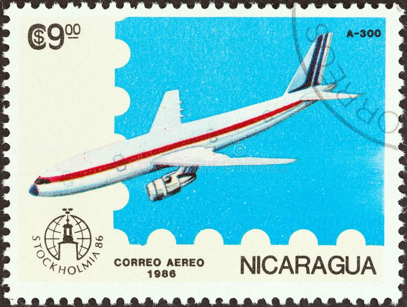 NICARAGUA - CIRCA 1986: A stamp printed in Nicaragua shows Airbus A300, circa 1986. NICARAGUA - CIRCA 1986: A stamp printed in Nicaragua from the `Stockholmia royalty free stock photos