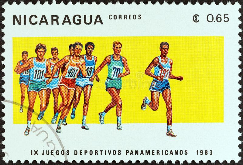 NICARAGUA - CIRCA 1983: A stamp printed in Nicaragua shows running, circa 1983. NICARAGUA - CIRCA 1983: A stamp printed in Nicaragua from the `9th Pan American royalty free stock photos