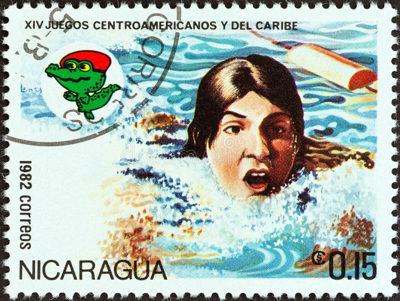NICARAGUA - CIRCA 1982: A stamp printed in Nicaragua shows Swimming, circa 1982. NICARAGUA - CIRCA 1982: A stamp printed in Nicaragua from the `14th Central royalty free stock images
