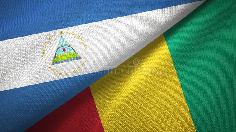 Nicaragua en Guinea twee vlaggen textieldoek, stoffentextuur stock afbeelding