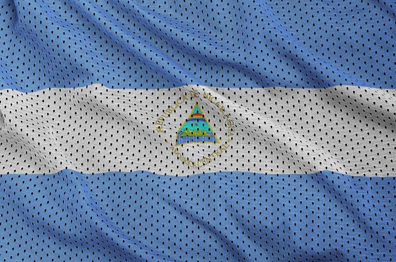Nicaragua flagga som skrivs ut på en fabr för ingrepp för polyesternylonsportswear arkivbilder