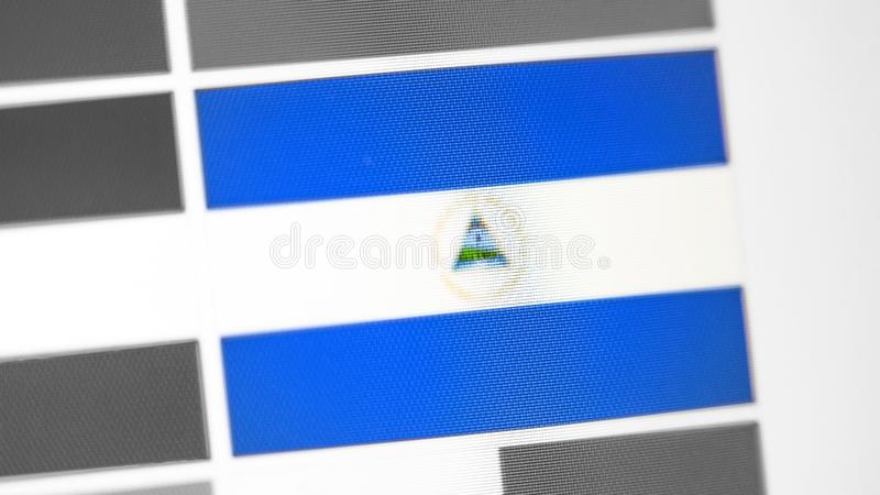 Nicaragua national flag of country. Nicaragua flag on the display, a digital moire effect. News of geography and geopolitics stock photography