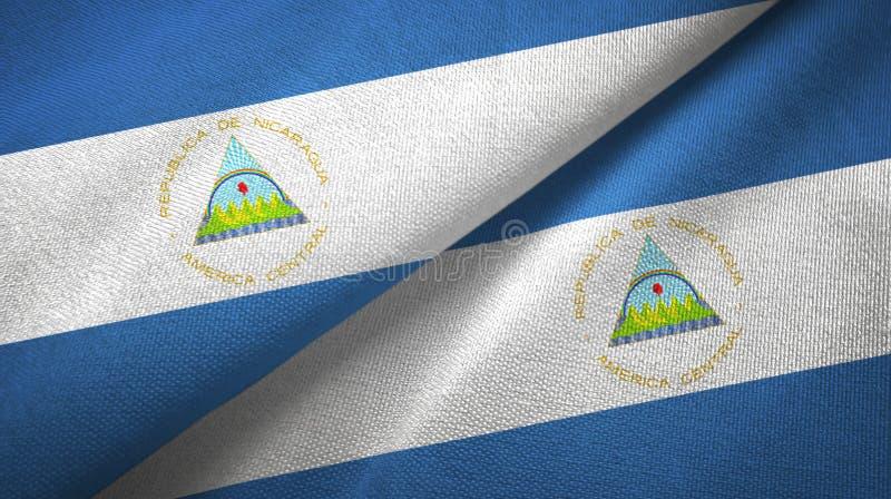 Nicaragua twee vlaggen textieldoek, stoffentextuur royalty-vrije stock fotografie