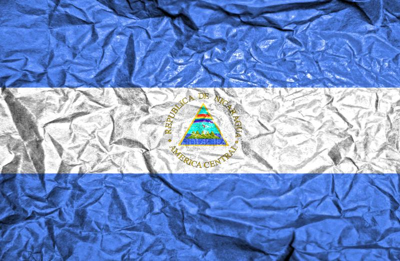 Nicaragua vintage flag on old crumpled paper background royalty free stock images