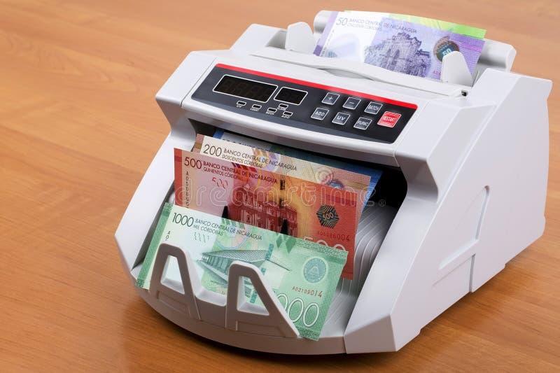 Nicaraguan Cordoba in een tellende machine royalty-vrije stock afbeelding
