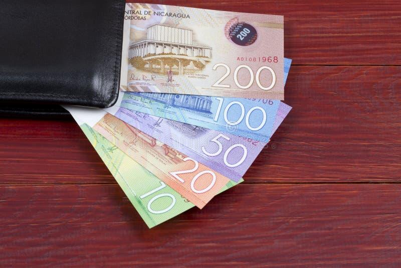 Nicaraguan geld in de zwarte portefeuille royalty-vrije stock afbeelding