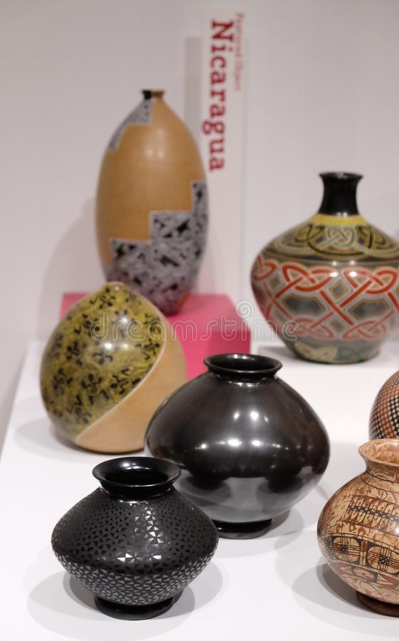 Nicaraguan Vases. A series of clay pots from the Grandes Maestros exhibit stock photos