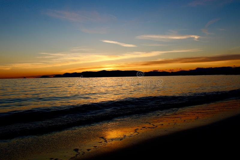 A nice afternoon at the beach with a view to the sunset in Tuscany, Italy. The sunset at the beach on a spring day in Italy. The sun was shining on this royalty free stock photos