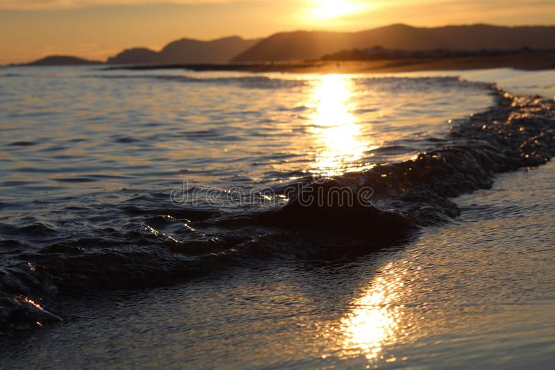 A nice afternoon at the beach with a view to the sunset in Tuscany, Italy. The sunset at the beach on a spring day in Italy. The sun was shining on this royalty free stock images