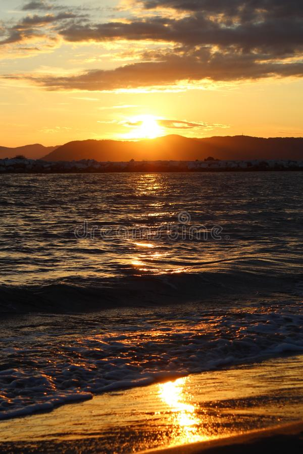 A nice afternoon at the beach with a view to the sunset in Tuscany, Italy. The sunset at the beach on a spring day in Italy. The sun was shining on this royalty free stock image