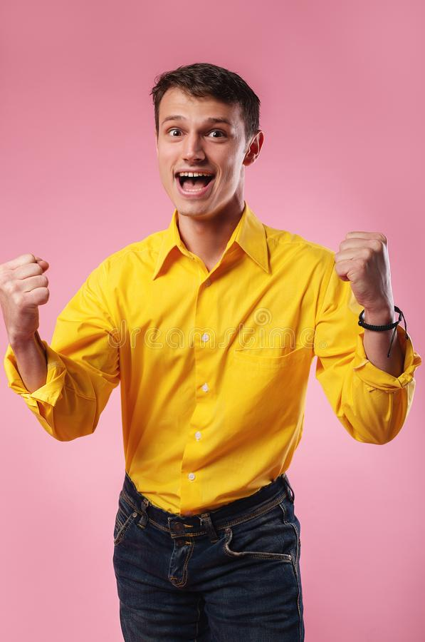 Nice attractive handsome cheerful cheery guy wearing yellow shirt stock image